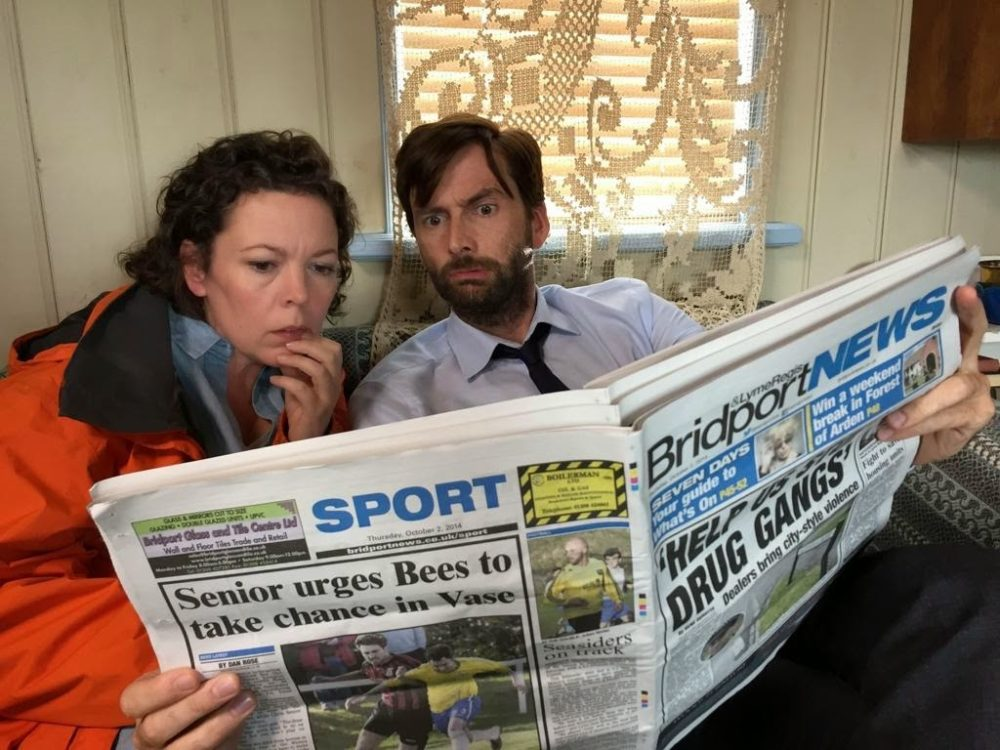 Miller and Hardy reading newspaper